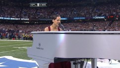 VIDEO: Singer plays a white piano at the 50-yard line while performing the national anthem.