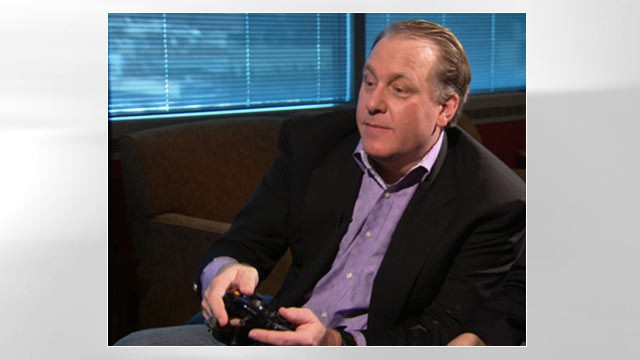 "PHOTO: Former MLB star Curt Schilling test drives his company's first video game ""Kingdoms of Amalur: Reckoning."""