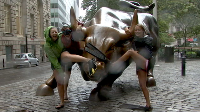 PHOTO: Alex Libby, Hannah Gabelmann and Janna Libby decided to survey the extent of Hurricane Irene?s fury by walking through lower Manhattan in scuba gear.
