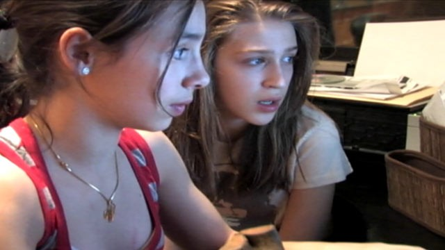 , searches the internet with her friend, in the new film Sexy Baby