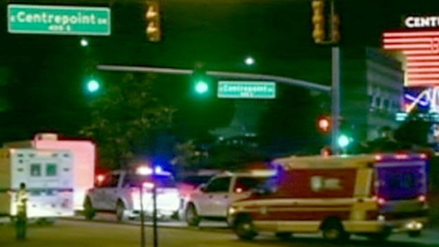 PHOTO: Police rush to the scene after a shooting at a movie theater in Aurora, Colo. on Friday, July 20, 2012.