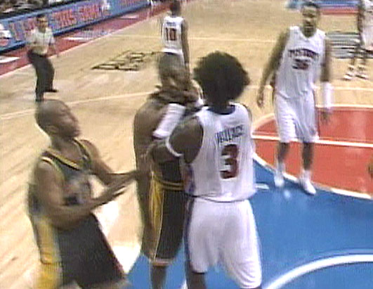 Ben Wallace of the Detroit Pistons shoves Ron Artest of the Indiana Pacers.