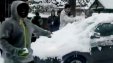PHOTO: University of Oregon students were caught on tape hurling snowballs at moving vehicles.