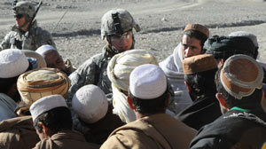 PHOTO Lieutenant Dave Womack, commander, 1st Battalion, 506th Infantry Regiment, 4th Brigade Combat Team, 101st Airborne Division, talks to men in the rural Paktika Province in southeastern Afghanistan