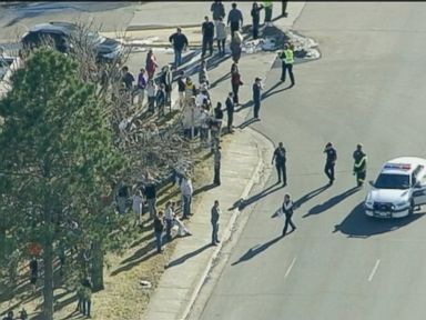 PHOTO: Students are seen outside Arapahoe High School in Centennial, Colo. on Dec. 13, 2013 where a  shooting has been reported.