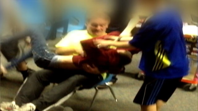 PHOTO: A video of Karla Kinney's 13-year-old son being dragged across the classroom by teacher and fellow student.