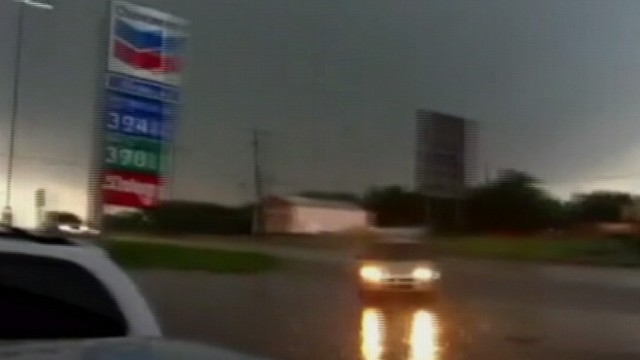 VIDEO: Drivers seeking shelter from powerful wind and rain pull into a gas station.