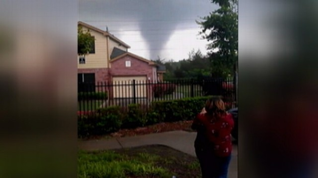 VIDEO: Brandy Kemps shouts at a friend as sirens warn of approaching tornado.