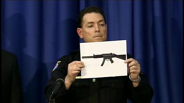 PHOTO: A police officer shows a picture of a gun similar to the one found in a University of Central Florida dorm room, March 18, 2013.
