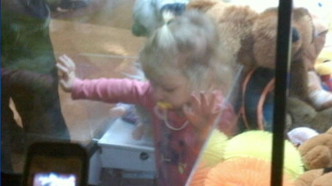 VIDEO: Toddler Climbs into Toy Vending Machine