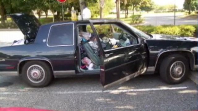 VIDEO: Florida police say they found garbage in jam-packed car on Walmart lot.