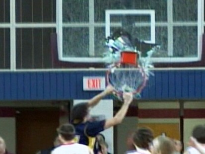 VIDEO: A 15-year-old basketball player causes glass to fly with his slam dunk.