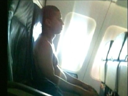 VIDEO: A flight is diverted after a naked man refuses to cover up.