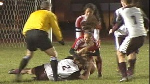 VIDEO: Fists fly on the field and in the stands at a high school soccer game in Rhode Island.