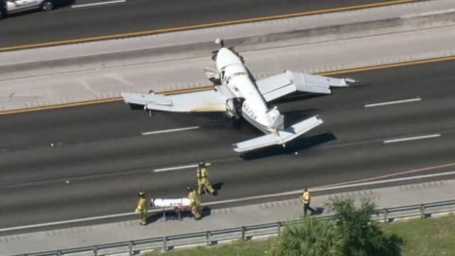 VIDEO: Two people onboard the single-engine plane were transported to the hospital.