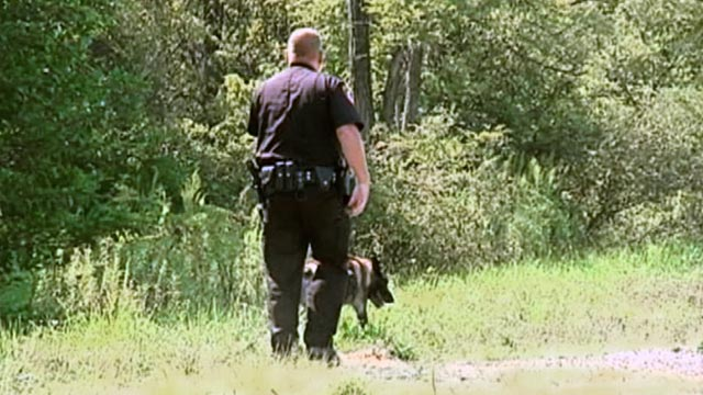 PHOTO: Sheriffs deputy and canine at crime scene
