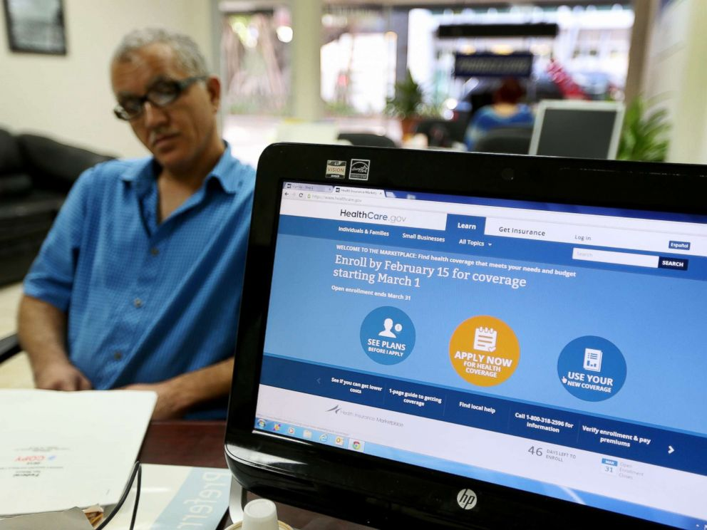 PHOTO: Hisham Uadadeh enrolls in a health insurance plan under the Affordable Care Act with the help of A. Michael Khoury at Leading Insurance Agency on Feb. 13, 2014, in Miami, Florida.