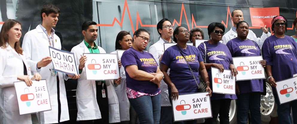 PHOTO: Nurses, doctors, health advocates and patients rally together in front of the Save My Care Bus near the Jackson Memorial hospital on March 2, 2017, in Miami.