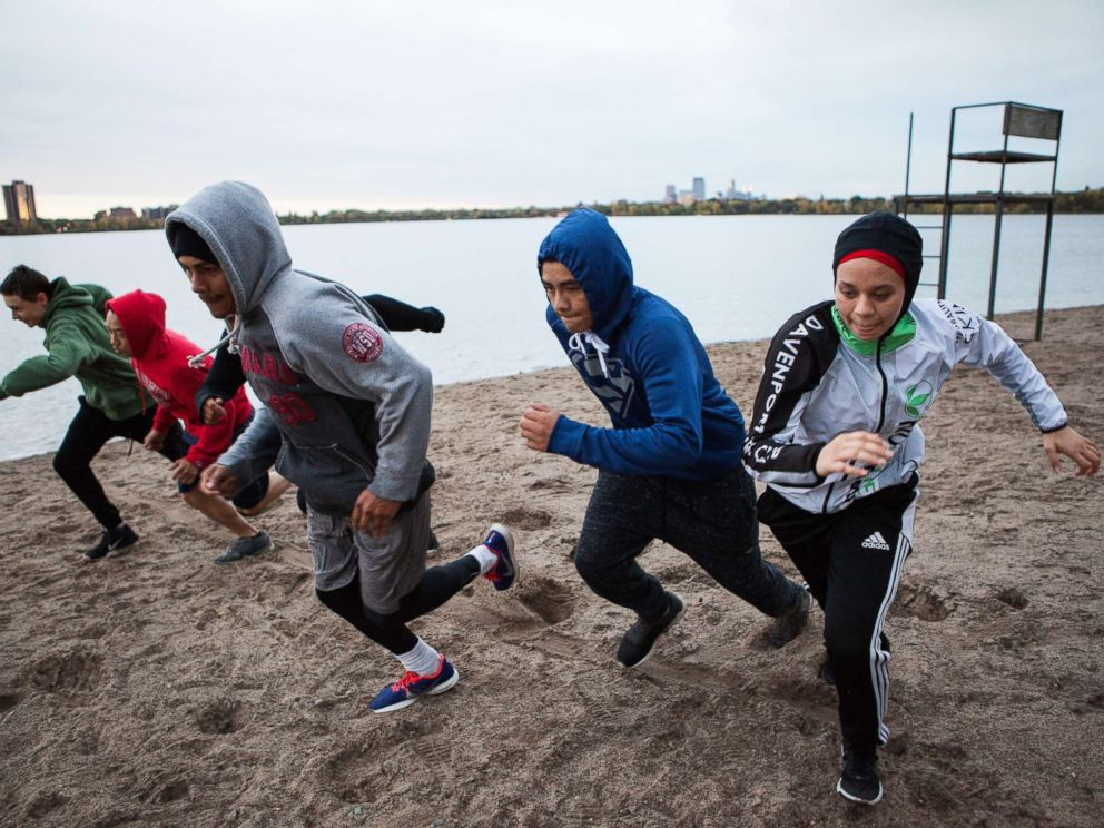 PHOTO: Amaiya Zafar sprints with fellow Circle of Discipline boxers by Lake Calhoun in Minneapolis before heading to the gym.