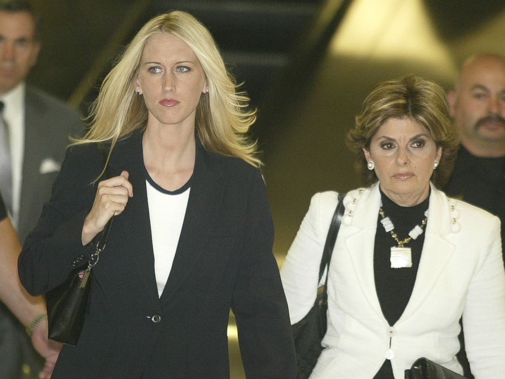PHOTO: Amber Frey, left, leaves the San Mateo County Courthouse flanked by her lawyer Gloria Allred after Freys second day of testimony in the Scott Peterson double murder trial on Aug. 11, 2004 in San Mateo, Calif.