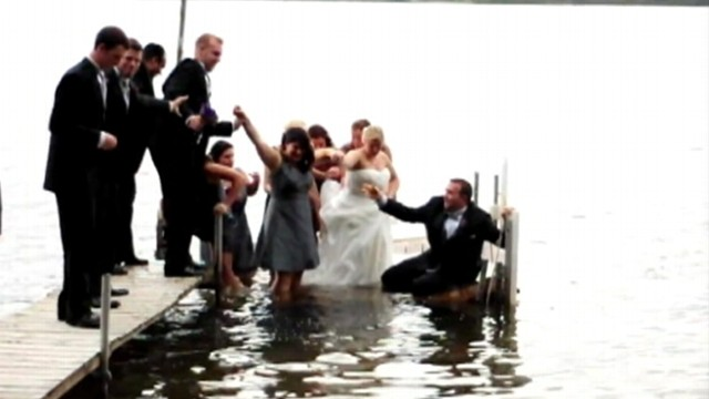 VIDEO: Wedding party fell into Lake Michigan while standing on a dock.
