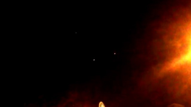 VIDEO: Three glowing objects appear to hover in the night sky over Brooklyn.