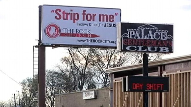 VIDEO: Sign above a gentlemans club paraphrases Biblical verse, encourages patrons to re-focus on family.