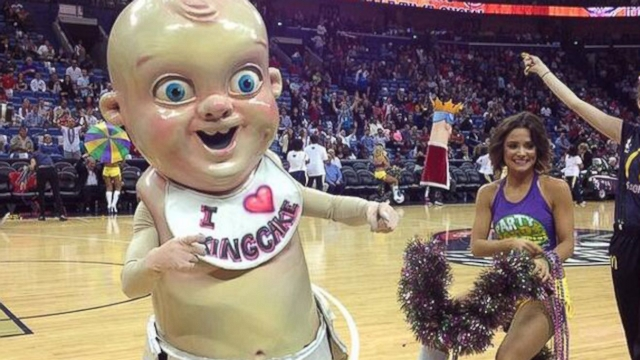 New Orleans Pelicans celebrate Mardi Gras with a giant replica of the tiny doll found in seasonal cake.