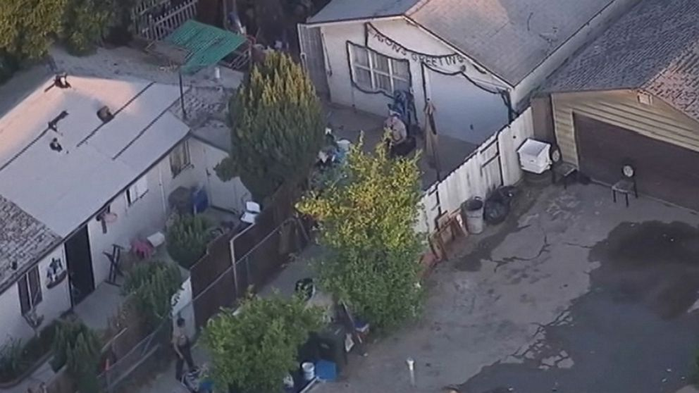 Los Angeles police investigate the stabbing deaths of three young girls at the womans home.