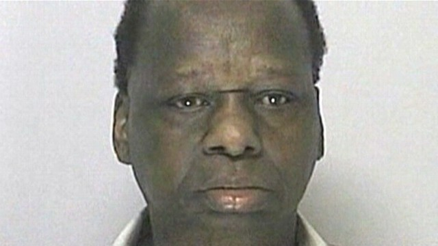 VIDEO: Onyango Obama, 67, was arrested after making a rolling a stop in Massachusetts.