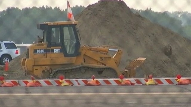 VIDEO: Construction crews discovered the bare bones while digging up a runway in Kansas City.