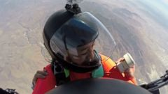 California firefighter popped the question with a fake ring while freefalling from 12,500 feet.