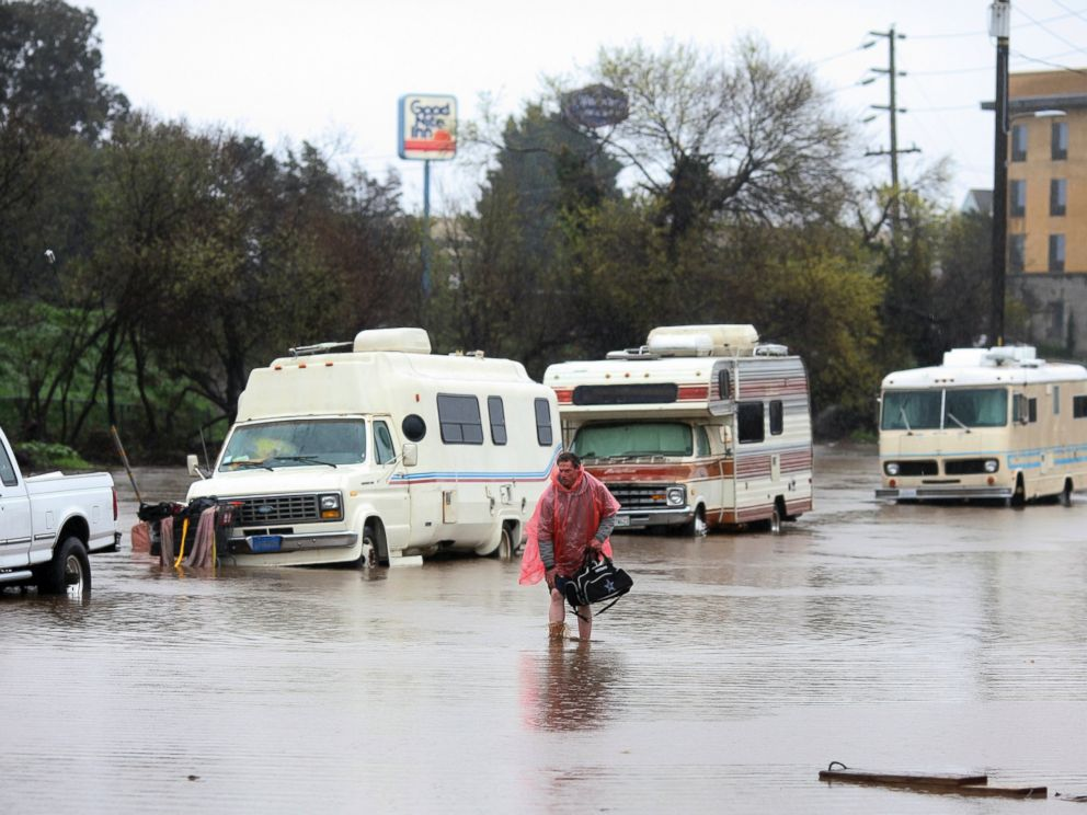 PHOTO: A man walks through a flooded street in Salinas, Calif. on Feb. 20, 2017.