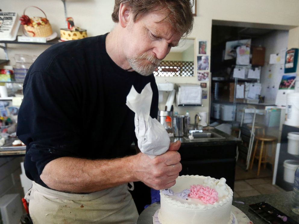 In this March 10, 2014, file photo, Masterpiece Cakeshop owner Jack Phillips decorates a cake inside his store in Lakewood, Colo.