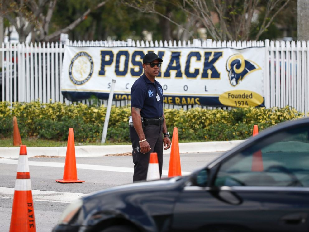 PHOTO: A security guard stands outside the entrance to the David Posnack Jewish Community Center and David Posnack Jewish Day School after people were evacuated because of a bomb threat, Feb. 27, 2017, in Davie, Fla.