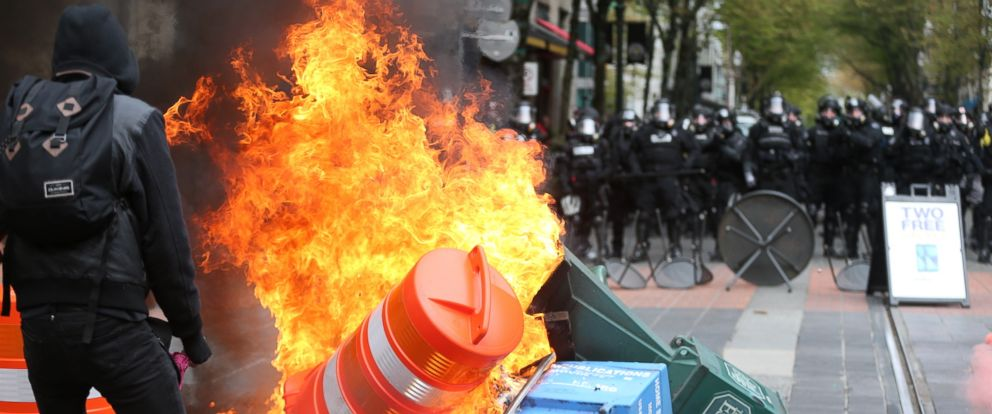 PHOTO: Police try to disperse people participating in a May Day rally in downtown Portland, Oregon, May 1, 2017.
