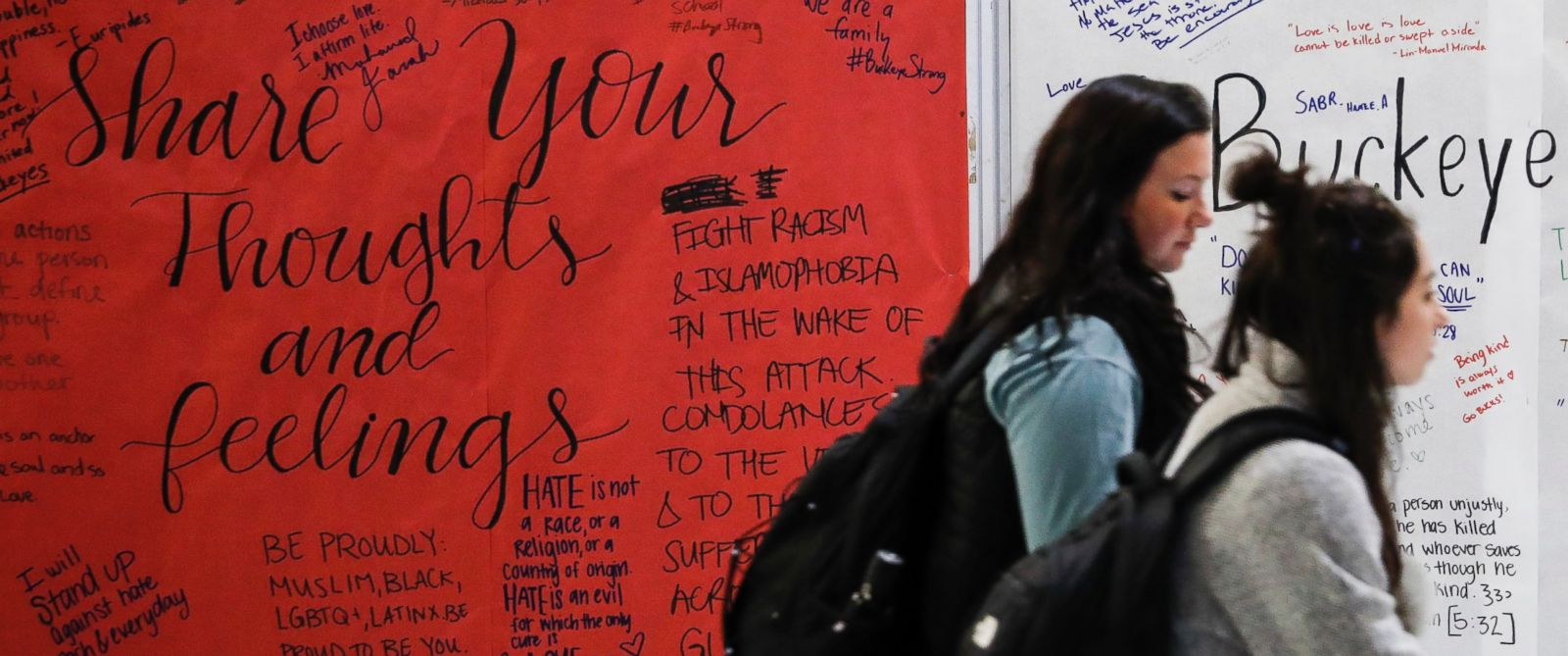 PHOTO: Students walk past a message board covered in community reactions at the Ohio State University student union, Nov. 29, 2016.