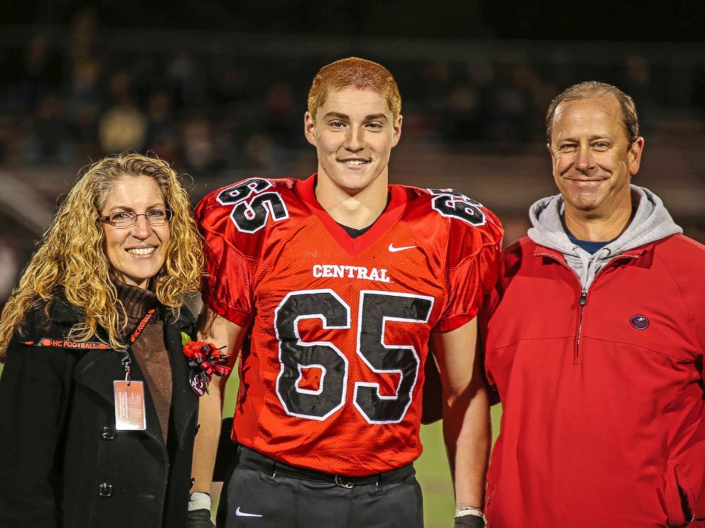PHOTO: This Oct. 31, 2014 photo shows Timothy Piazza, center, with his parents Evelyn Piazza, left, and James Piazza, right, during Hunterdon Central Regional High School footballs Senior Night at the high schools stadium in Flemington, N.J.