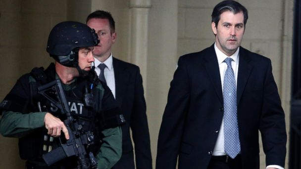 PHOTO: Former South Carolina police officer Michael Slager walks from the Charleston County Courthouse under the protection of the Charleston County Sheriff's Department after a mistrial was declared for his trial in Charleston, S.C., Dec. 5, 2016.