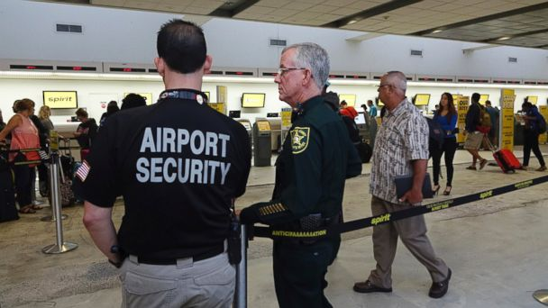 PHOTO: Airport Security and a Broward Sherriff's Deputy keep an eye on the line at Spirit Airlines, Tuesday, May 9, 2017, at the Fort Lauderdale-Hollywood International Airport in Fort Lauderdale, Fla.