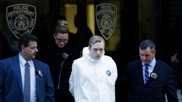PHOTO: James Harris Jackson is escorted out of a police precinct in New York, Wednesday, March 22, 2017.