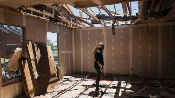 PHOTO: Stephanie Quezada looks at the damage to the second floor of her father's church, Primera Iglesia Bautista, in Canton, Texas, April 30, 2017.