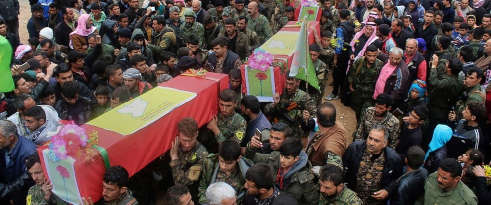 PHOTO: Fighters from the predominantly-Kurdish Syrian Democratic Forces carry their comrades coffins, killed on April 11, 2017 by a misdirected airstrike by the U.S.-led coalition, during a funeral procession in Tal al-Abyad, Syria, April 13, 2017.