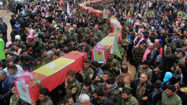 PHOTO: Fighters from the predominantly-Kurdish Syrian Democratic Forces carry their comrades' coffins, killed on April 11, 2017 by a misdirected airstrike by the U.S.-led coalition, during a funeral procession in Tal al-Abyad, Syria, April 13, 2017.