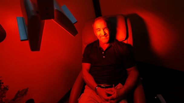 PHOTO: Ric Rooney sits in a newly-installed room in his updated tanning salon northeast of downtown Colorado Springs, Colo., March 22, 2017.