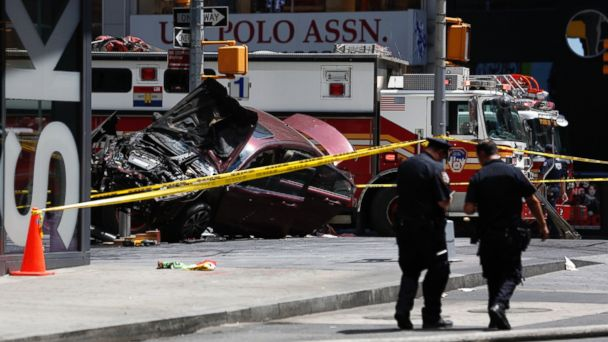 PHOTO: A smashed car sits on the corner of Broadway and 45th Street in New York's Times Square after ploughing through a crowd of pedestrians, May 18, 2017.