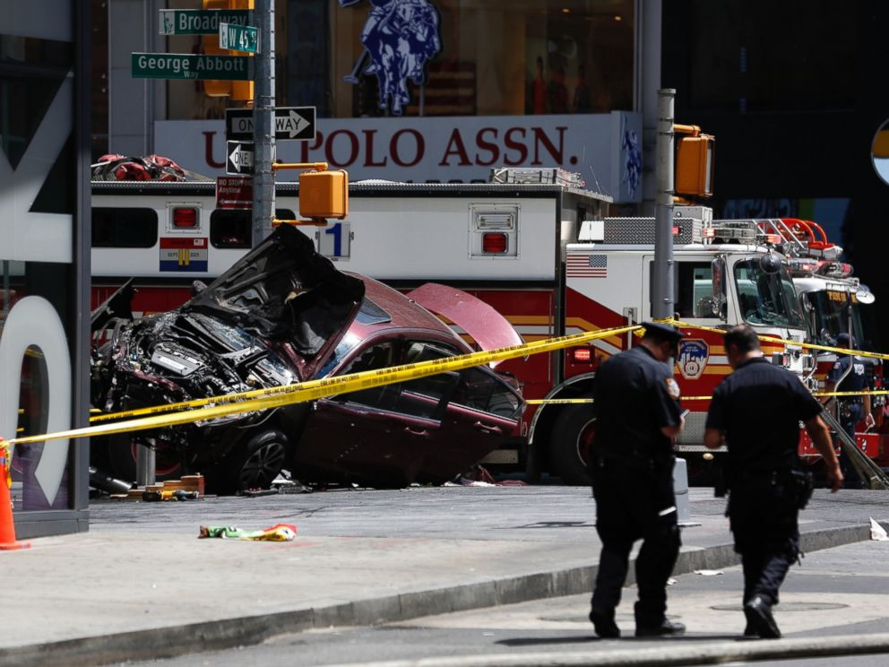 PHOTO: A smashed car sits on the corner of Broadway and 45th Street in New Yorks Times Square after ploughing through a crowd of pedestrians, May 18, 2017.