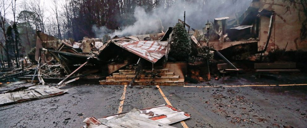 PHOTO: Smoke rises from the remains of the Alamo Steak House, Nov. 30, 2016, in Gatlinburg, Tennessee after a wildfire swept through the area.