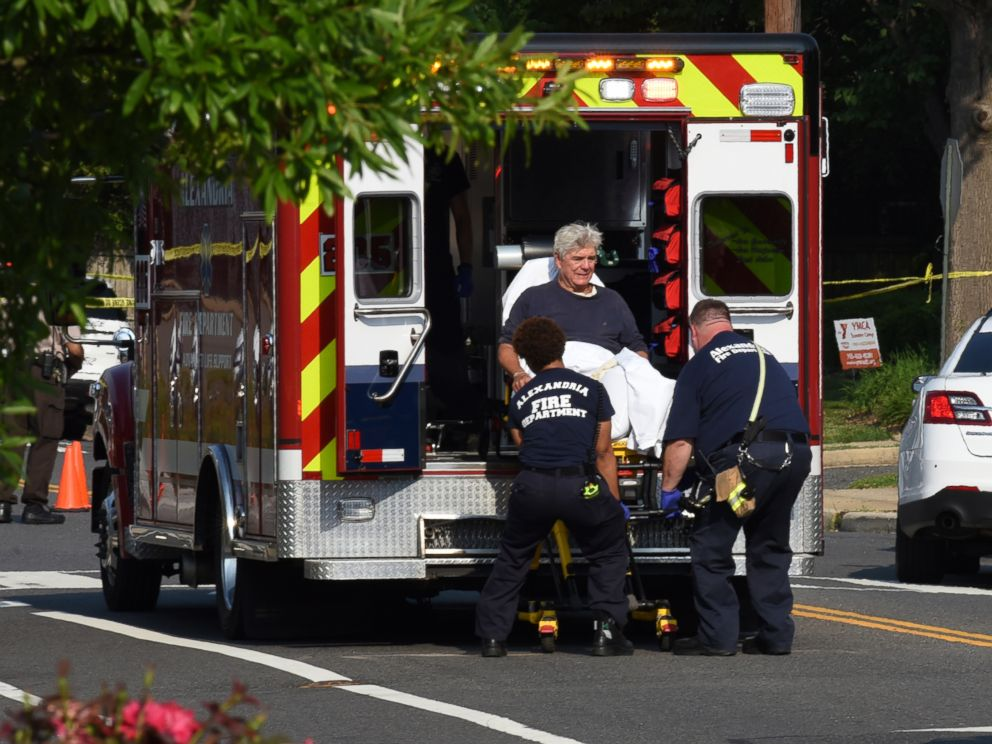 PHOTO: Rep. Roger Williams is placed into an ambulance at the scene of a shooting at a baseball field in Alexandria, Va., June 14, 2017.