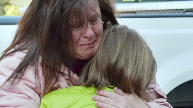 PHOTO: A mother hugs her daughter following a shooting at the Sandy Hook Elementary School in Newtown, Conn., about 60 miles northeast of New York City on Dec. 14, 2012.